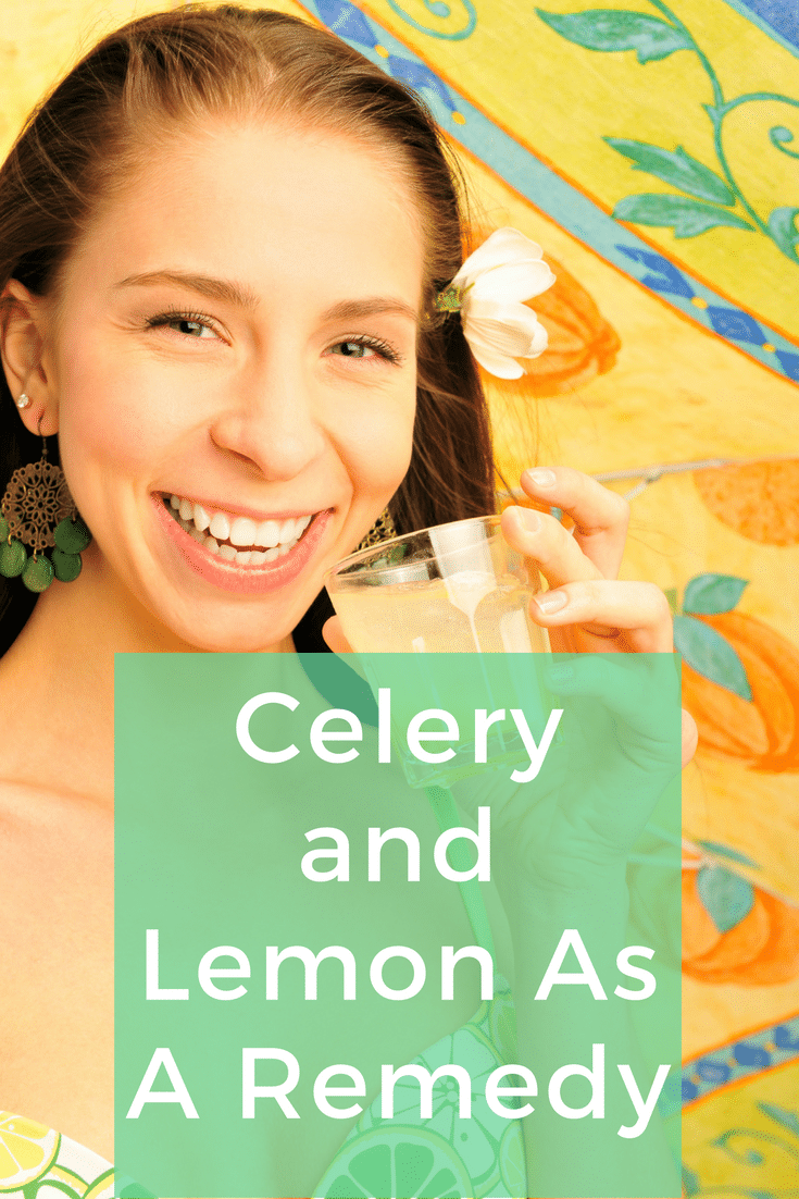 Girl with a glass with celery and lemon juice