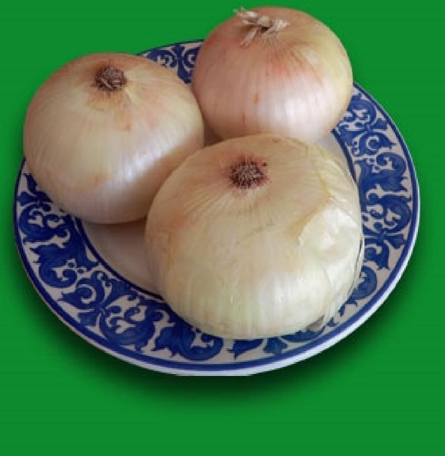 three whole onions on the plate
