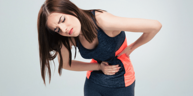 Fitness woman having irritable bowel syndrome